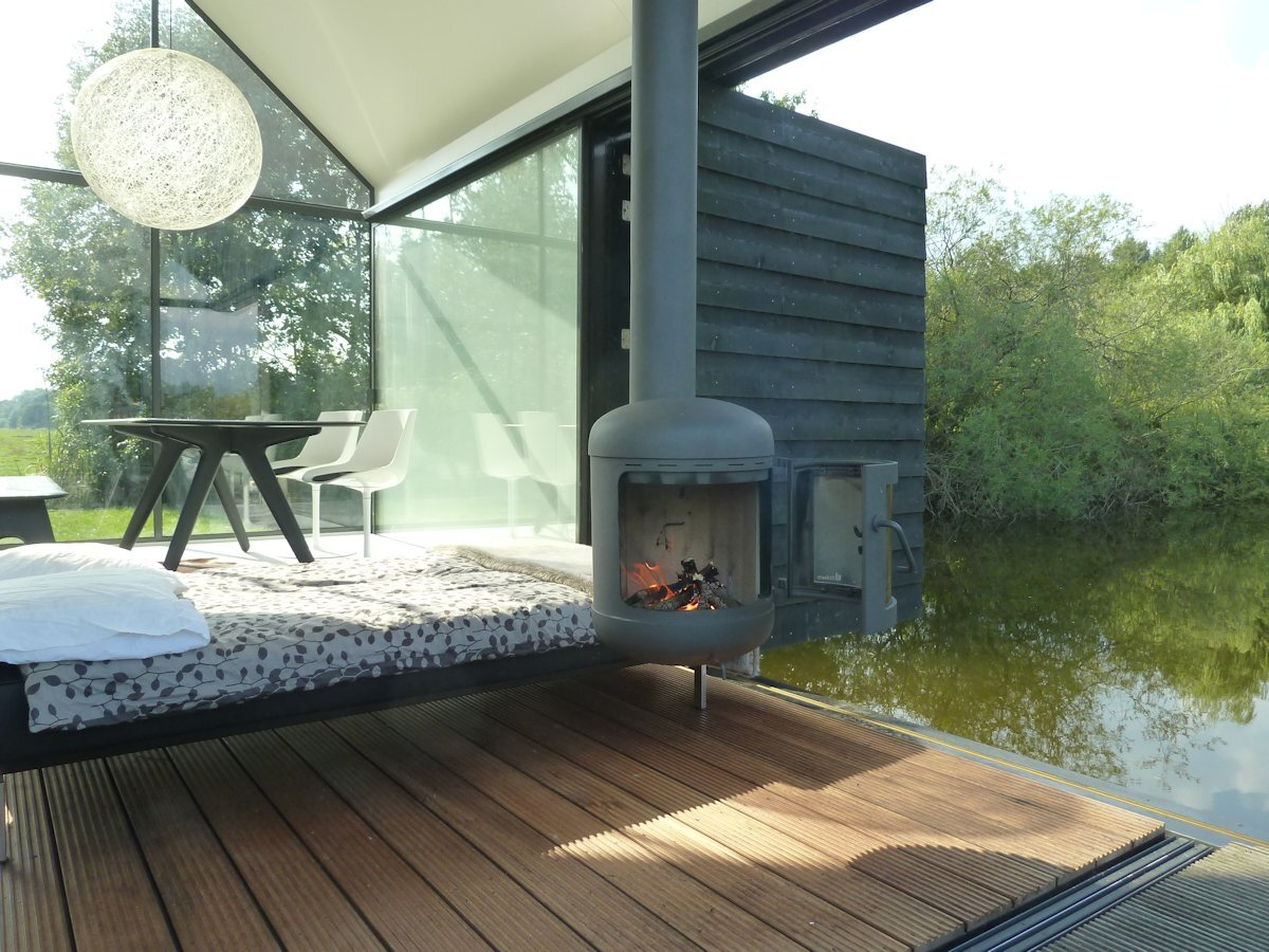 Cool A Tiny House Set On A Lake In The Netherlands Largest Home Design Picture Inspirations Pitcheantrous