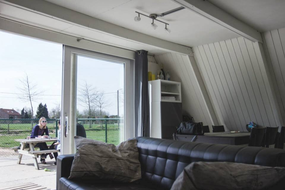 The Tipi - A Frame Cottage - Belgium - Living Area Patio Doors - Humble Homes