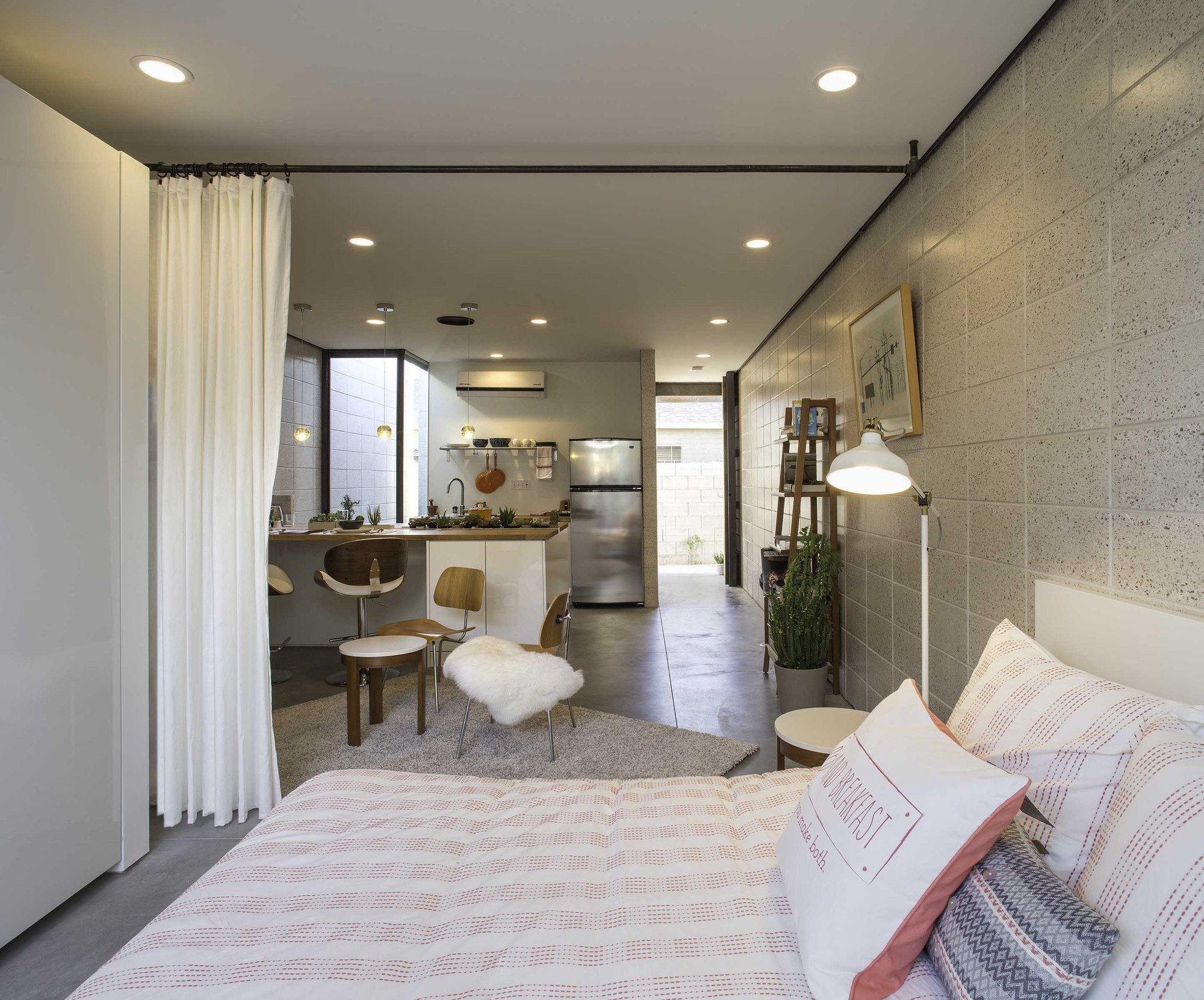 White stone studios modern micro apartments in downtown for Hall design for small house