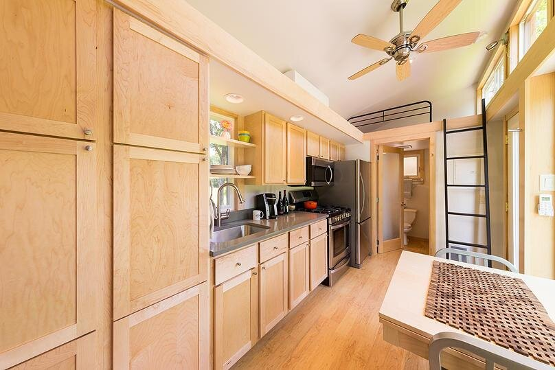 Escape traveler a tiny house on wheels that comfortably sleeps 6 Kitchen design for tiny house