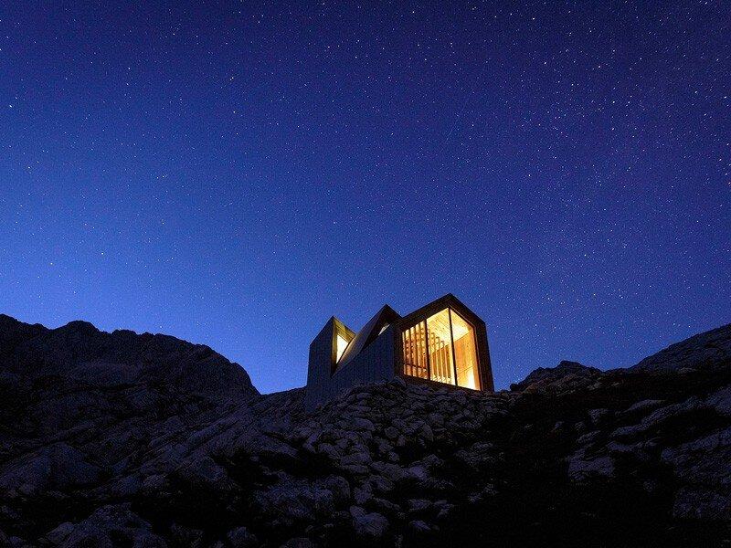 Skuta Mountain Cabin - OFIS architects - Slovenia - Exterior At Night - Humble Homes