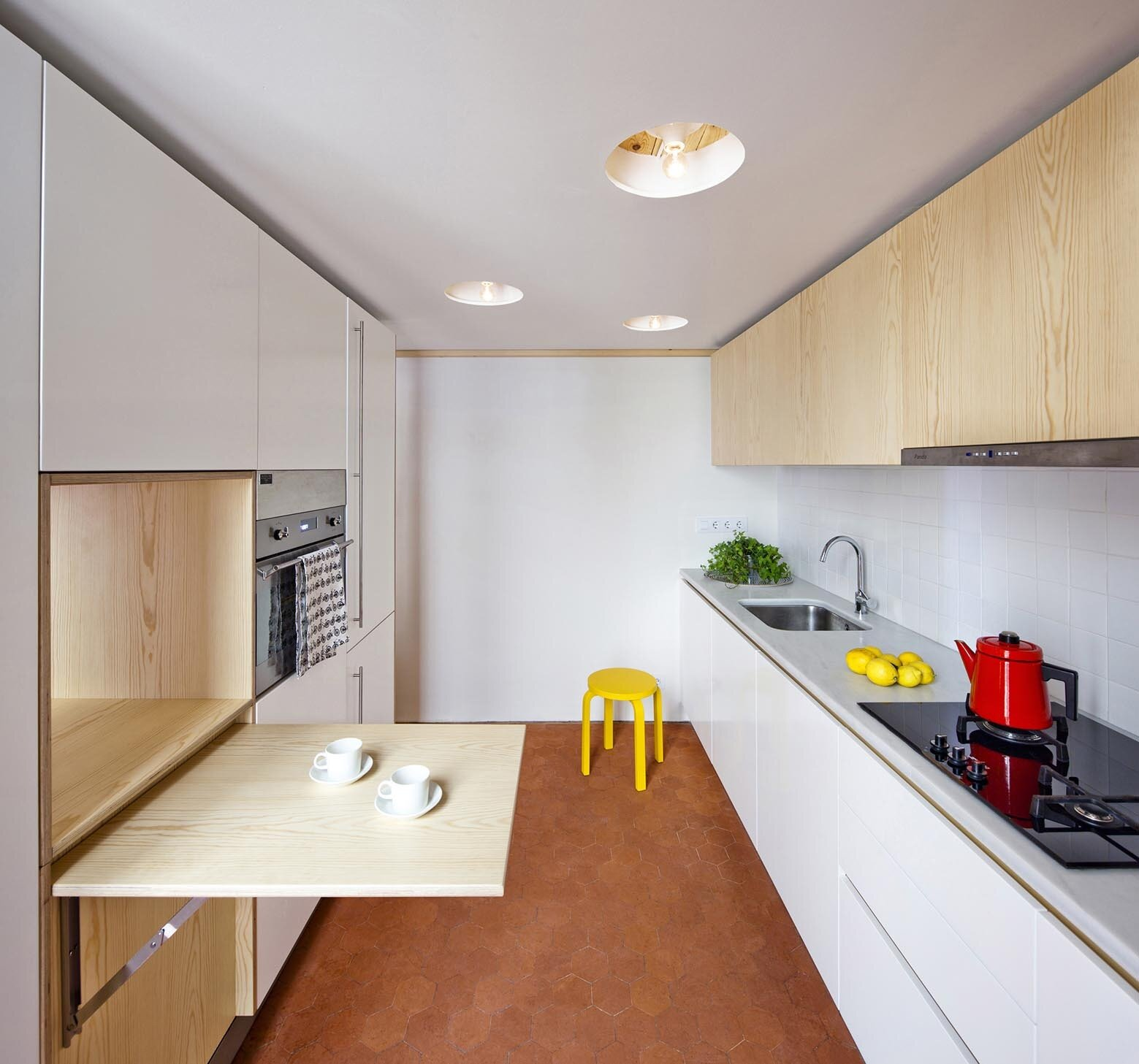 Compact Apartment Kitchens: Bach Arquitectes Revamp A Traditional Apartment In Spain