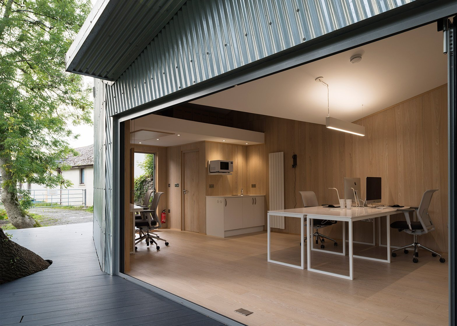 The rivershed an idyllic office on the banks of the for Metal building interior ideas