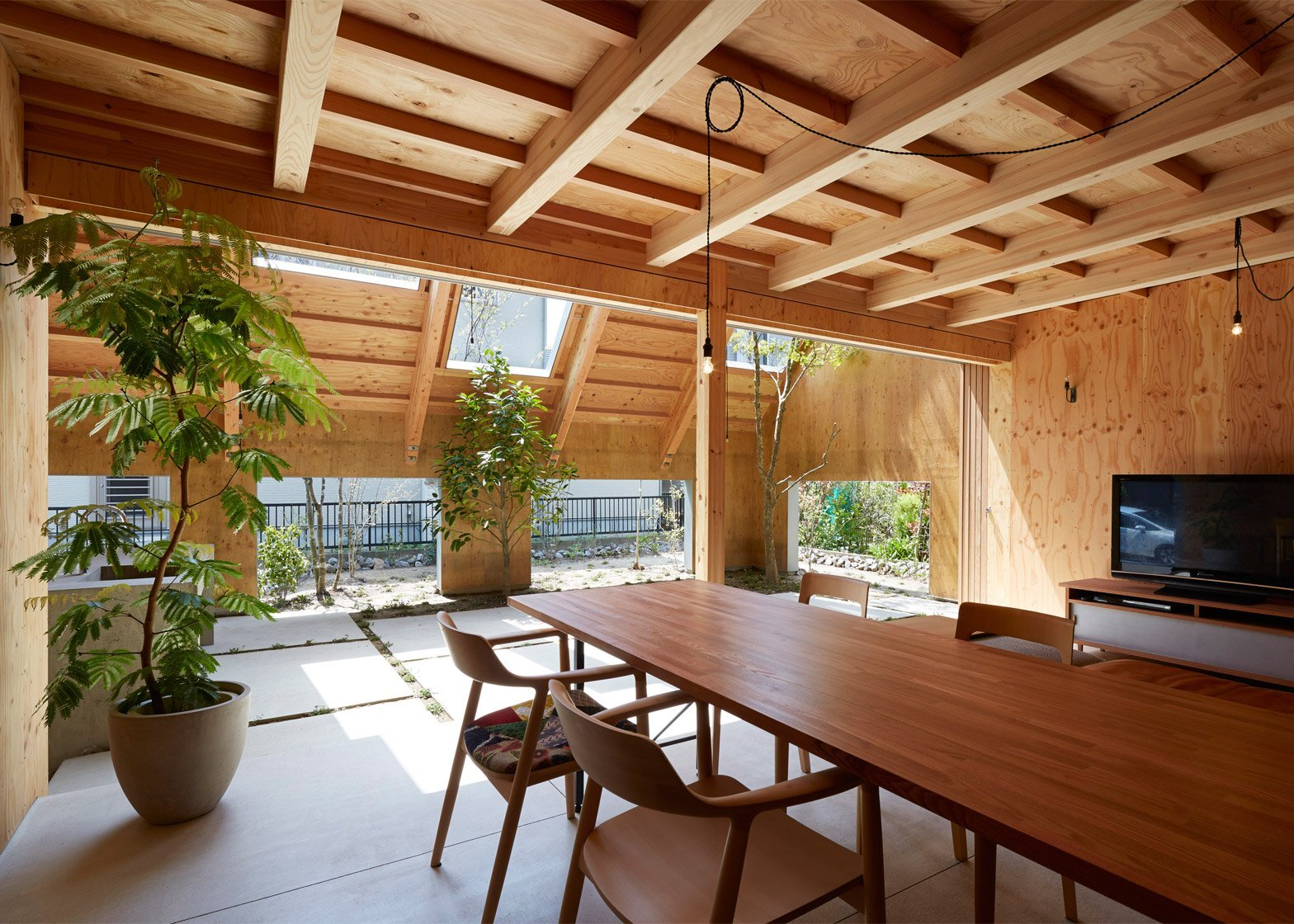Japanese family home features a sheltered exterior garden for Asian office decor