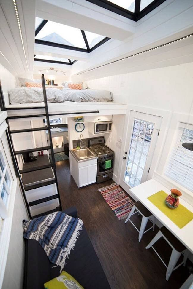 This tiny house on wheels takes inspiration from beach houses Interior pictures of tin homes