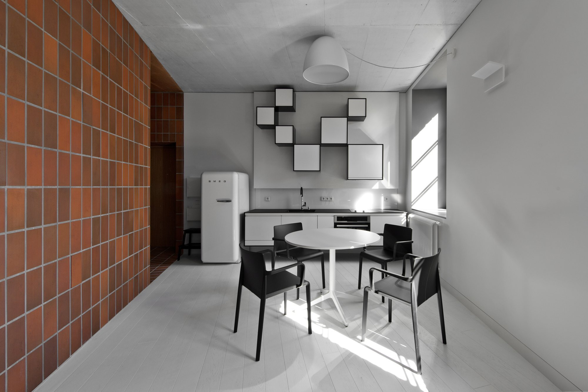 Bazillion - YCL Studio - Lithuania - Kitchen and Dining Area - Humble Homes