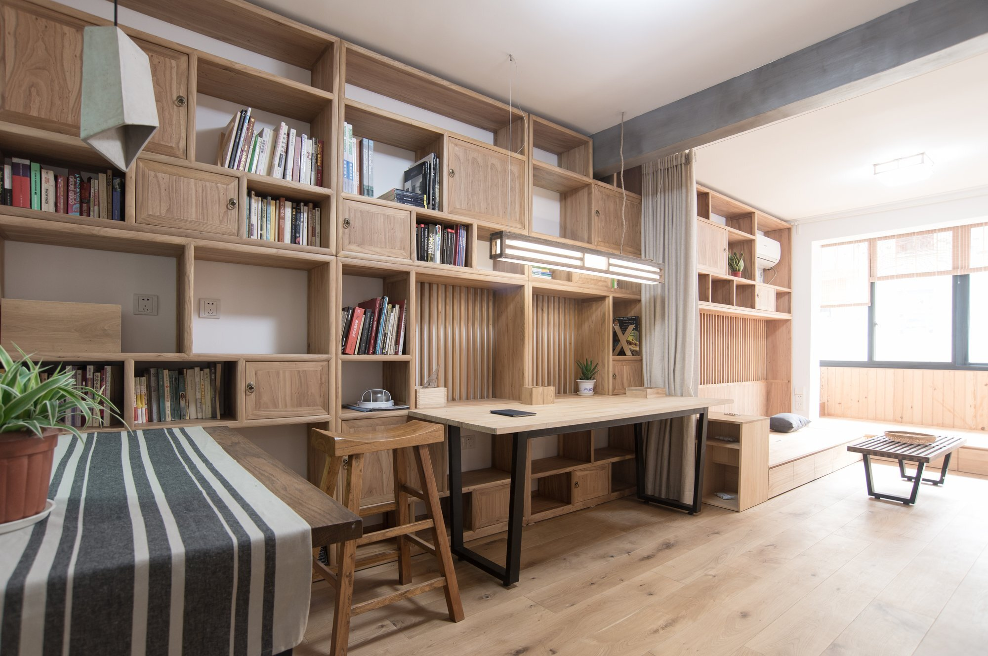 small chinese apartment mixes modern and traditional elements