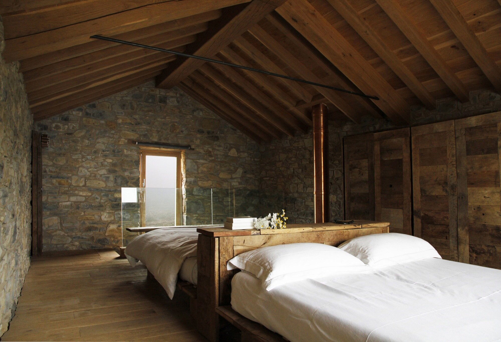 Cottage Restoration - Studio Contini - Italy - Loft Bedroom - Humble Homes