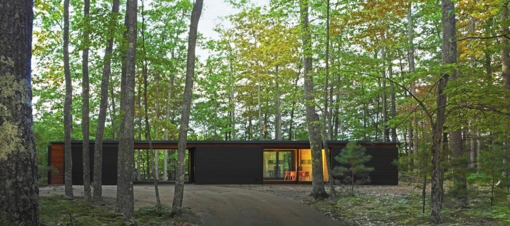 Linear cabin is a simple contemporary retreat overlooking for Contemporary home builders wisconsin