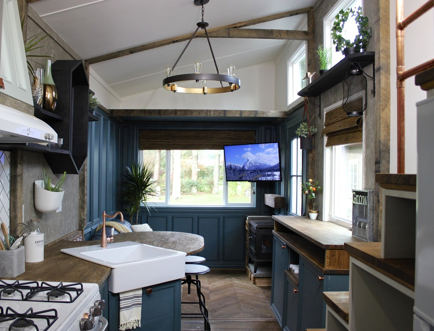 Urban craftsman is an eclectic tiny house on wheels from - Tiny house living room ...